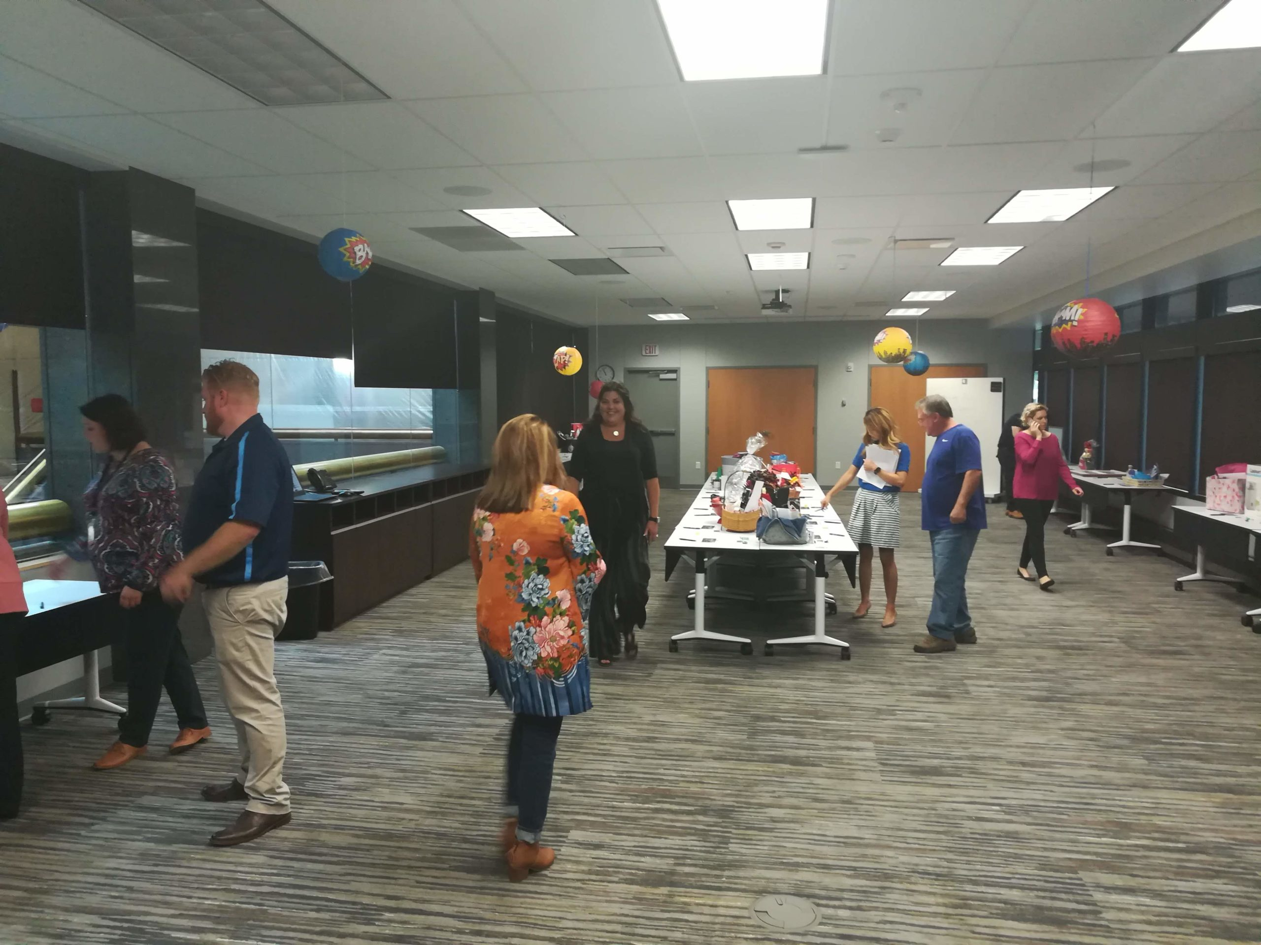 We had some pretty impressive offerings for our silent auction, including two flatscreen Mac desktop computers, tickets and VIP parking to a KC Royals game and a Huskers poster signed by Nebraska's very own superhero Scott Frost.